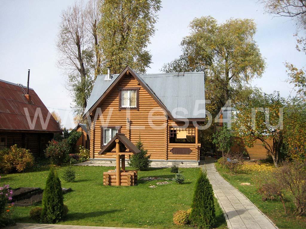 Дачный дом с террасой из оцилиндрованного бревна д. 180 мм